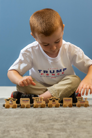 The wooden train in the Trump store